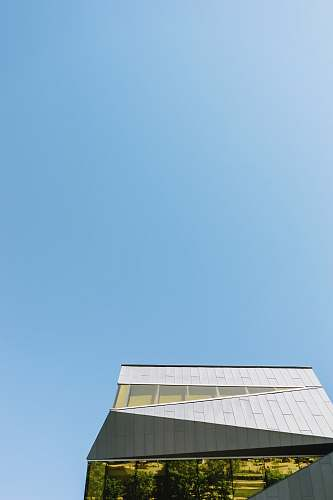 photo sky low-angle photography of white concrete building under clear blue sky building free for commercial use images