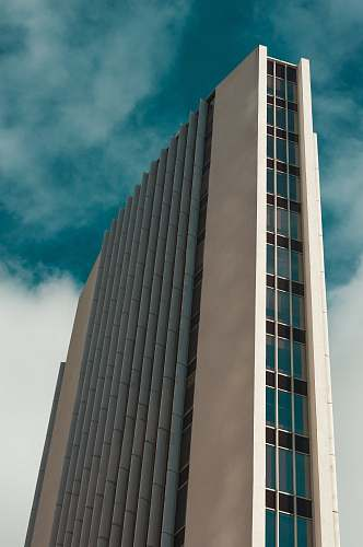 architecture low angle photography of multi-story high rise building during daytime city