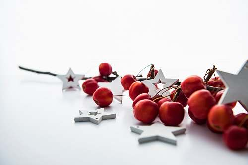 holiday red cherries and white star decorations xmas