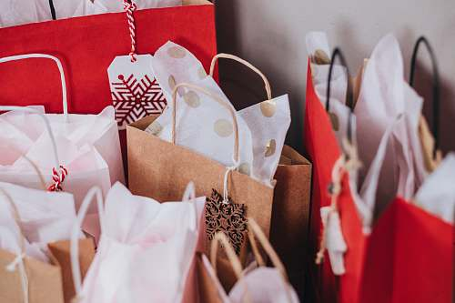 holiday shallow focus photography of paper bags gift