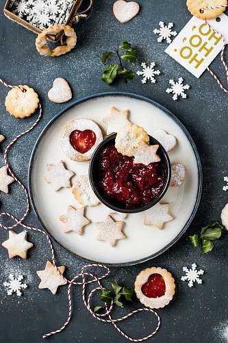 food strawberry jam with star biscuits on plate holiday