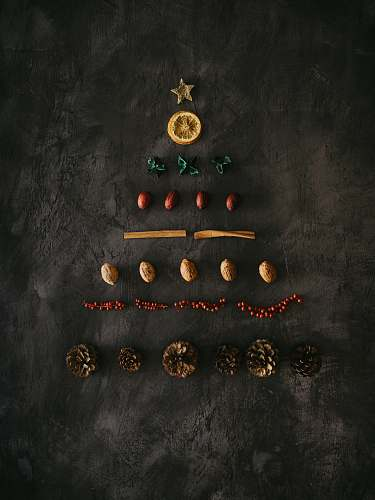 christmas assorted-color ornaments on black surface plant