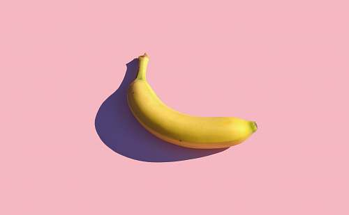 food riped banana on pink surface banana