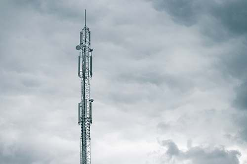 tower gray radio tower under the cloudy sky during daytime electrical device