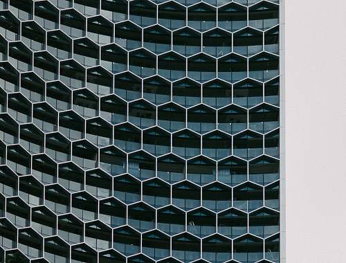 architecture A building with glass hexagon shaped windows pattern