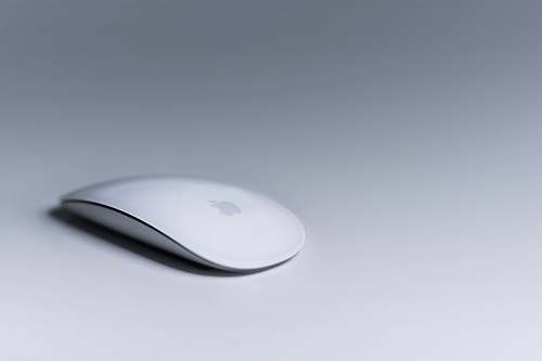 grey Magic Mouse on white surface white