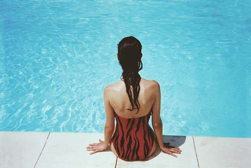 person woman wearing black and red monokini summer