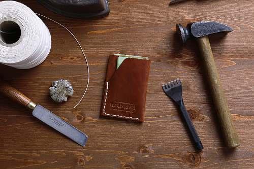 tool hammer beside brown book knife
