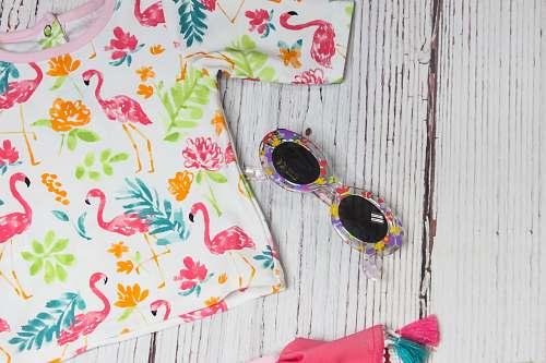 friendswood white and multicolored crew-neck shirt near sunglasses united states