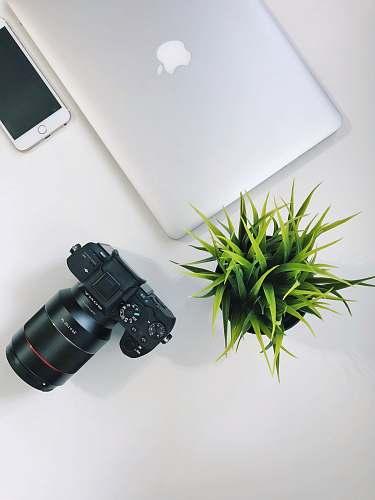 binoculars silver MacBook near black Sony DSLR camera electronics