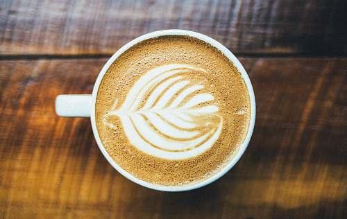 drink capuchino on white ceramic mug coffee cup