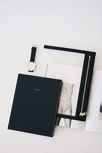 minimalism flat lay photo of watch, notebook, and watch blackboard