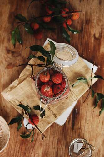 meal flat lay photography of jar of red fruits dish