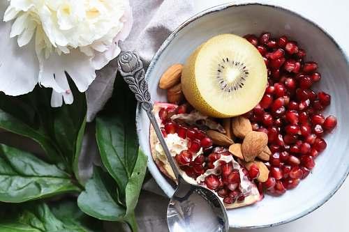 flower kiwi and peanuts on bowl fruit