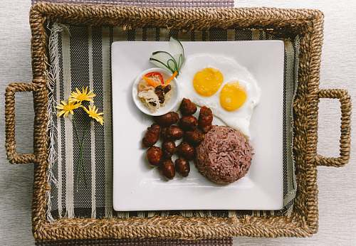 meal plate of foods on brown wicker tray breakfast