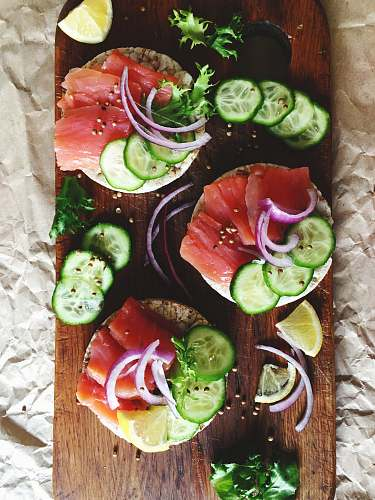 flatlay raw fish filet with vegetable and spices on chopping board flat lay
