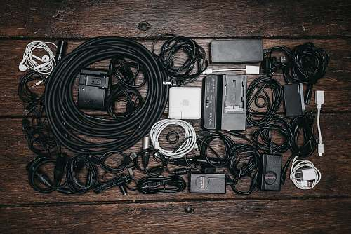 saskatoon black cable lot and electronic devices on brown wooden surface canada