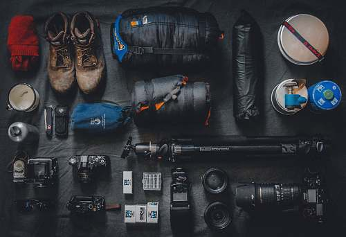 camping photo of assorted cameras and bags explore