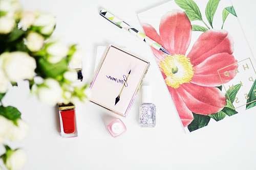 flower pink Emma box beside nail polish new york