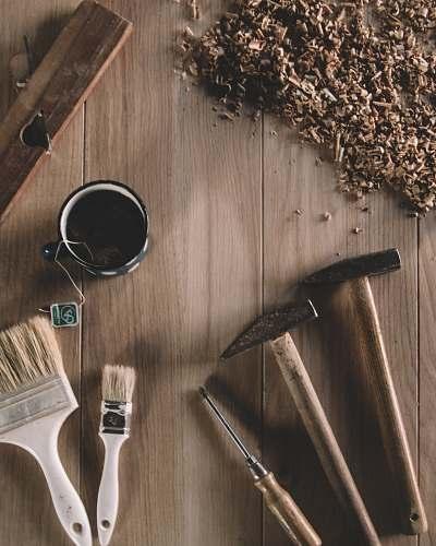 brown two hammers beside screwdriver worktop
