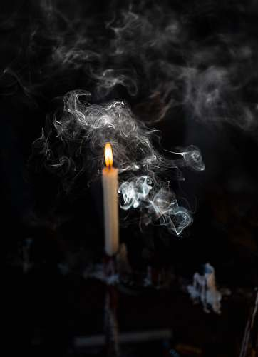 smoke lighted candle on candlestick cape town