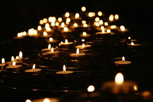 light low-angle photo of lightened candles yoga