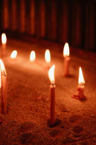 fire selective focus photo of lit candles flame