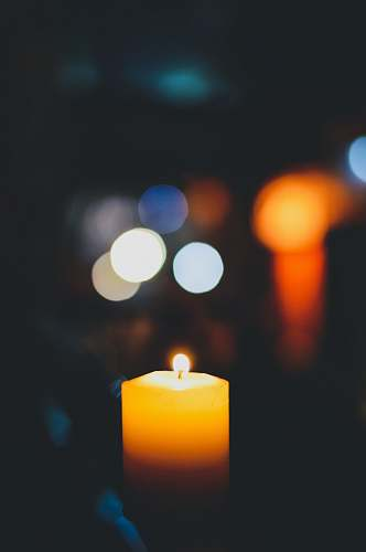 photo new delhi selective focus photography of lighted yellow candle india free for commercial use images