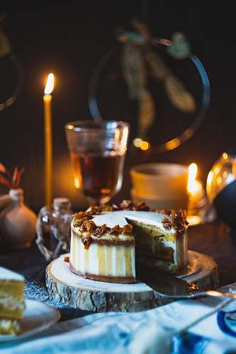 photo confectionery shallow focus photo of cake near lighted candle food free for commercial use images