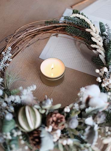 photo wreath tealight candle on brown surface candlelight free for commercial use images
