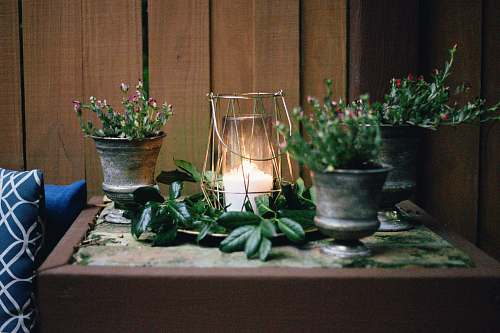 photo pottery lighted candle on table beside pots flora free for commercial use images
