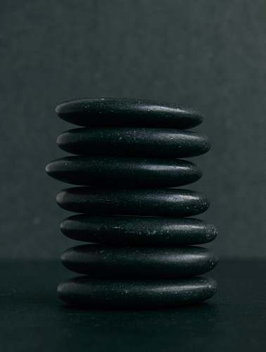 spiral selective focus photography of seven stacked stones coil