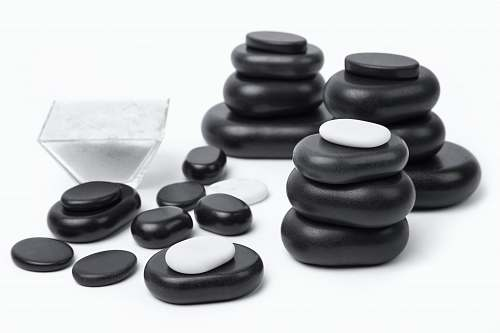 game black and gray stones on white surface pebble