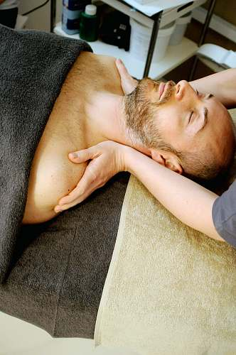 person man lying on bed massage