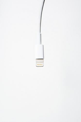 A white USB cord dangling from above.