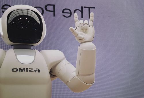 photo Asimo robot doing handsign free for commercial use images
