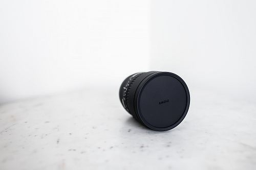 black camera lens on white surface