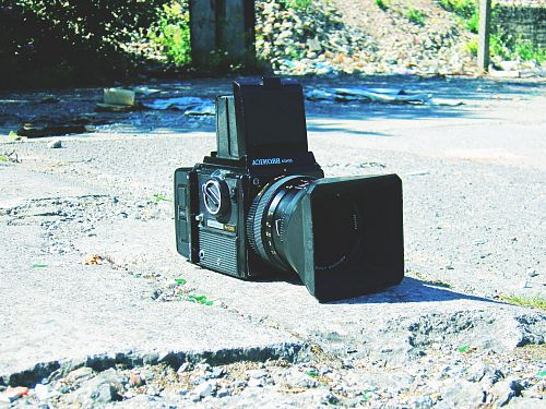 photo black camera on stone free for commercial use images