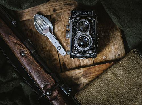 black land camera beside spoon and fork