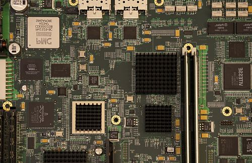 closeup photography of green and black computer motherboard
