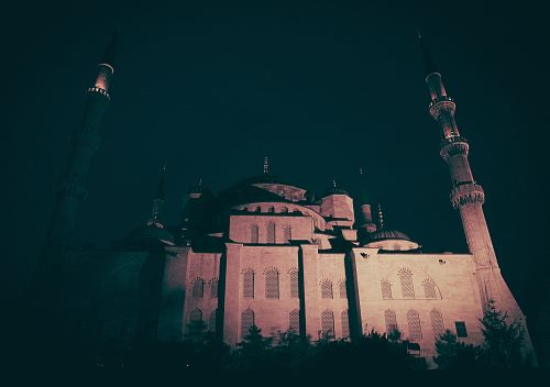 concrete mosque at night