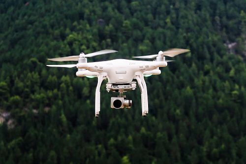 photo drone flying in sky free for commercial use images