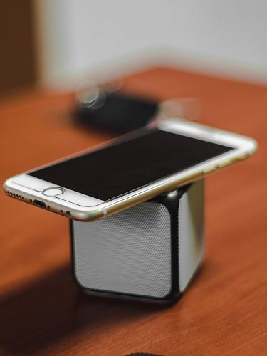 photo gold iPhone 6 on top of Bluetooth portable speaker free for commercial use images