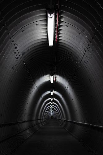 photo gray concrete tunnel with light free for commercial use images