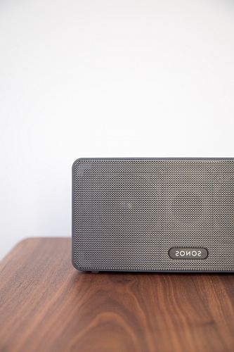 gray Sonos speaker on table