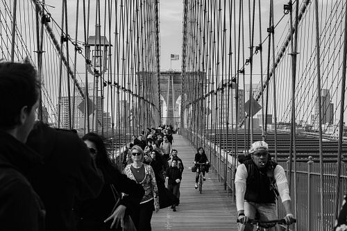 photo grayscale photo of people on bridge free for commercial use images