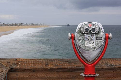 photo grey and red coin operated binoculars in front of seawaves under nimbus clouds during daytime free for commercial use images