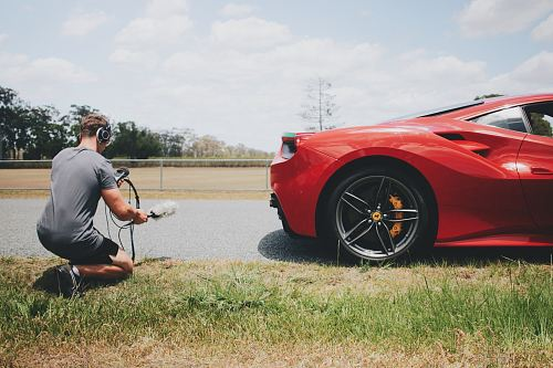 photo man behind car holding microphone measuring sound free for commercial use images