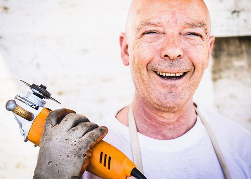 photo man holding orange angle grinder free for commercial use images