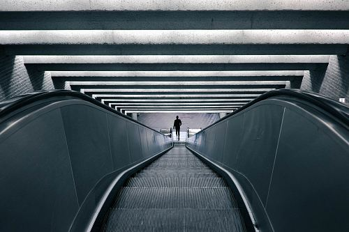 photo man on escalator turned on free for commercial use images